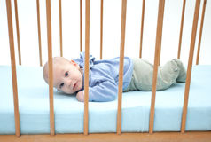 Two months baby boy lying in a cot Stock Images