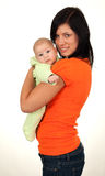 Two months old baby in his mothers arms Royalty Free Stock Photo