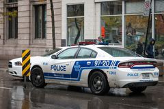 Two Montreal Police Service SPVM cars standing in front of a local police station. stock photography
