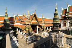 Two monuments of the guards at the entrance of Emerald Buddha temple complex in Bangkok, Thailand.  royalty free stock images