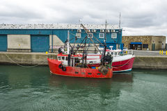 Two  moored small fishing boats in Ireland Royalty Free Stock Images