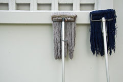 Two Mop Upside Down Royalty Free Stock Photo
