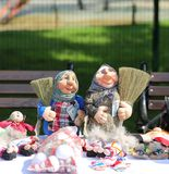 Two Mordovian dolls with sweepers and money in hands Royalty Free Stock Image