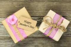Two Mother's Day gifts on wood Royalty Free Stock Photos