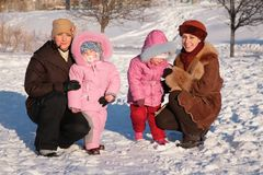 Two mothers with children. Outdoor in winter Stock Photography