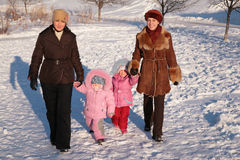 Two mothers with children. On walk in winter Royalty Free Stock Image