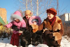Two mothers with children and dog Stock Photography