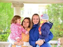 Two mothers with children on the walk in  gazebo Stock Photos