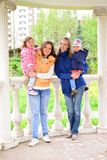 Two mothers with children on the walk in  gazebo Royalty Free Stock Photography