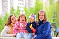 Two mothers with children on the walk in  gazebo Royalty Free Stock Photo
