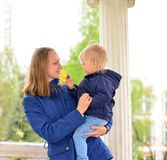 Two mothers with children on the walk in  gazebo Stock Photography