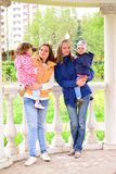 Two mothers with children on the walk in  gazebo Royalty Free Stock Photos