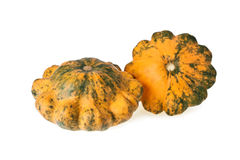 Two motley scalloped squashes isolated on white Royalty Free Stock Image