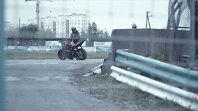 Two moto sportsman give five and sit on motorcycles. HD stock video footage