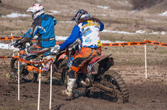 Two motocross racers. Beating two motocross racers with mud on motorbike royalty free stock images