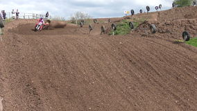 Two Motocross riders during a race stock footage