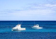 Two motor boats in blue sea Royalty Free Stock Photography