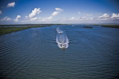 Two motor boats navigating. Two small motor boats navigating in a beautiful sea Royalty Free Stock Images