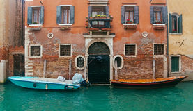 Two motor boats near entrance of the house Royalty Free Stock Photo