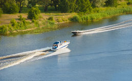 Two motor boats Stock Images