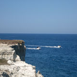 Two motorboats on horizon. Seascape with two motorboats, Puglia, Italy Stock Images