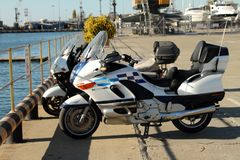 Two motorcycles are on the quay of the seaport of Adler royalty free stock image