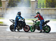 Two motorcyclist on track doing burnouts Stock Image