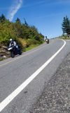 Two motorcyclists coming down a mountain road Royalty Free Stock Photography