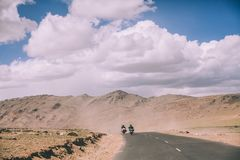two motorcyclists on mountain road in Indian Himalayas, stock photos