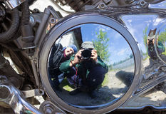 Two motorcyclists are reflected in brilliant motor stock images
