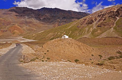 Two Motorcyclists on the Winding Mountain Road in the High-Altitude Mountain Desert in the Himalayas Stock Photography