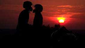 Two mountain biker - comantic couple silhouette in Royalty Free Stock Images