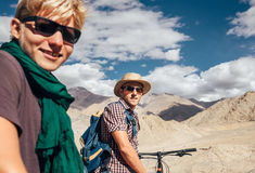 Two mountain bikers portrait on Himalaya view Royalty Free Stock Photos