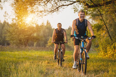 Two mountain bikers riding bike in the forest Royalty Free Stock Photography