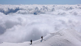 Two mountain climbers on an exposed ridge in the Swiss Alps Royalty Free Stock Images