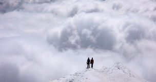 Two mountain climbers on an exposed ridge in the Swiss Alps Royalty Free Stock Photos