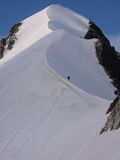 Two mountain climbers on the famous Bianco Ridge in Switzerland Royalty Free Stock Photo