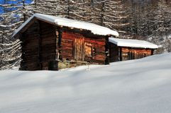 Two mountain huts in the snow in winter Royalty Free Stock Images