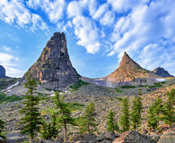 Two mountain peaks. Form bend in form of mathematical parabola. Rocks `The Brothers`. Ergaki Ridge. Western Sayan. Russia Stock Image