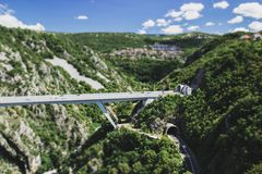 Two mountain tunnel and bridge one over the other,  tilt-shift e Stock Image