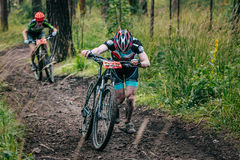 Two mountainbiker in a uphill race Stock Images
