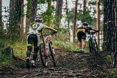 Two mountainbiker in a uphill race Royalty Free Stock Photography