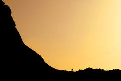 Two mountaineers on the ridge, at the sunrise Royalty Free Stock Images