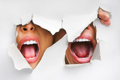 Two mouths screaming from hole in wall. Portrait of two mouths screaming from hole in wall Royalty Free Stock Photo