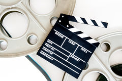 Two movie reels for 35 mm film projector with clapper board and Royalty Free Stock Image