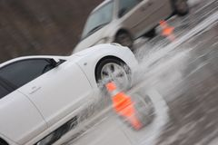 Two moving cars on ice. With water spray Royalty Free Stock Photos