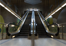 Two moving underground escalator in the subway Stock Photography