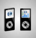 Two MP3 players. Abstraction of two MP3 players on a gray background for various necessities Royalty Free Stock Image