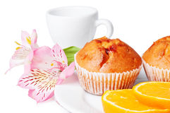 Two muffins, orange and flowers Royalty Free Stock Image