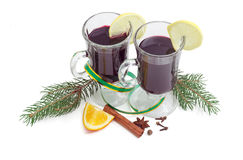 Two mug of mulled wine, mulling spices and fir branches Stock Photography